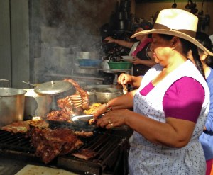 Boyacanese woman preparing fresh chicken and pork